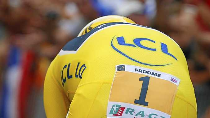 Number one ... Froome, wearing the overall leader's yellow jersey