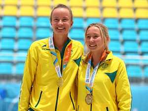 Australians Rebecca Ingram and Carrie Van Rensburg with their gold medals after winning the girl's beach volleyball at the 2017 Youth Commonwealth Games in the Bahamas.