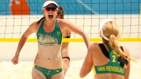 Rebecca Ingram and Carrie Van Rensburg of Australia celebrate during the gold medal beach volleyball match against Ella Akkerman and Jasmine Pepi-Milton of New Zealand.
