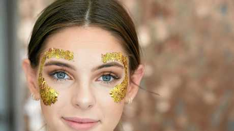 Audrey Clark, of Melbourne, gets glitter fashion on ready for Splendour in the Grass 2017.
