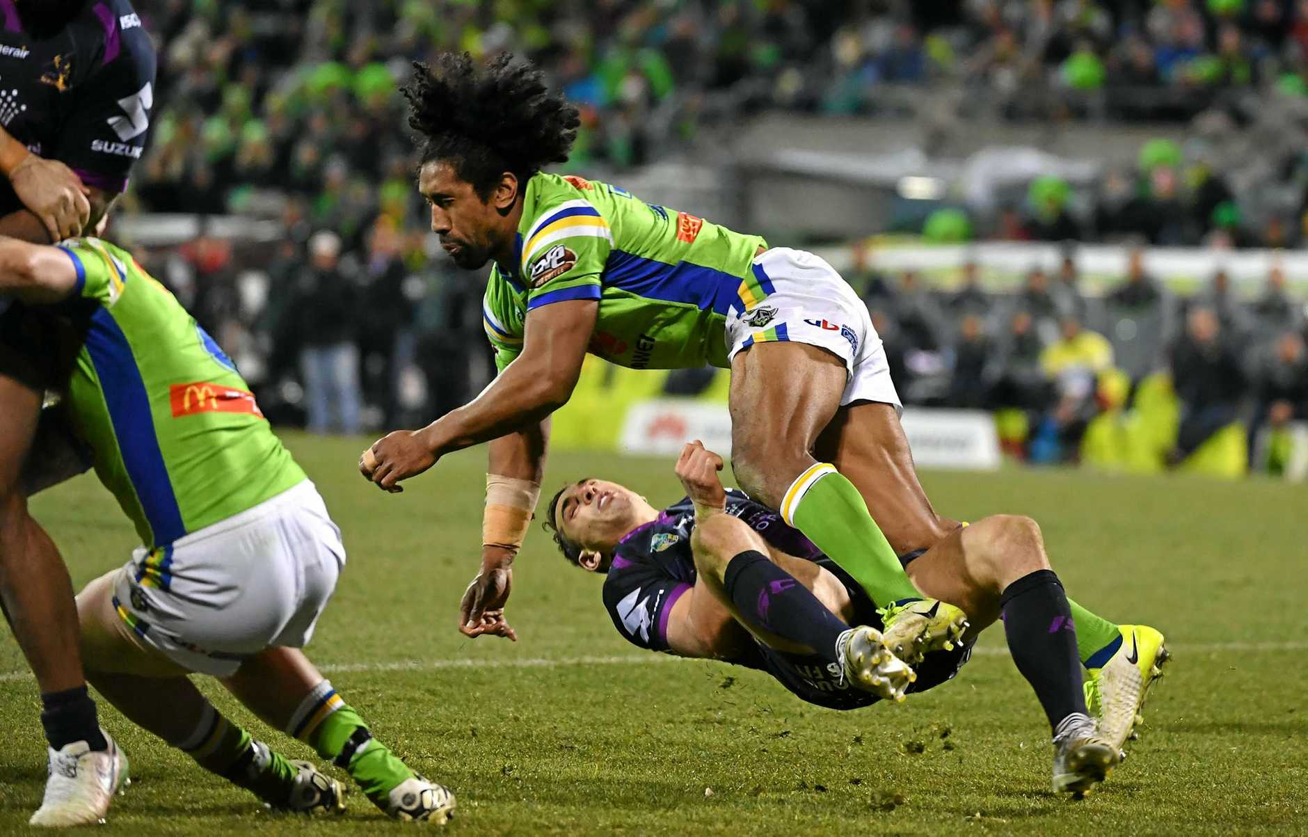 Raiders forward Iosia Soliola irons out Storm fullback Billy Slater after he had offloaded the ball during their Round 20 clash.