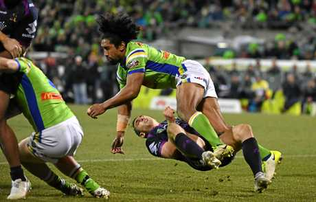 Billy Slater of the Storm is knocked out after being hit by Raiders forward Sia Soliola during their Round 20 match.