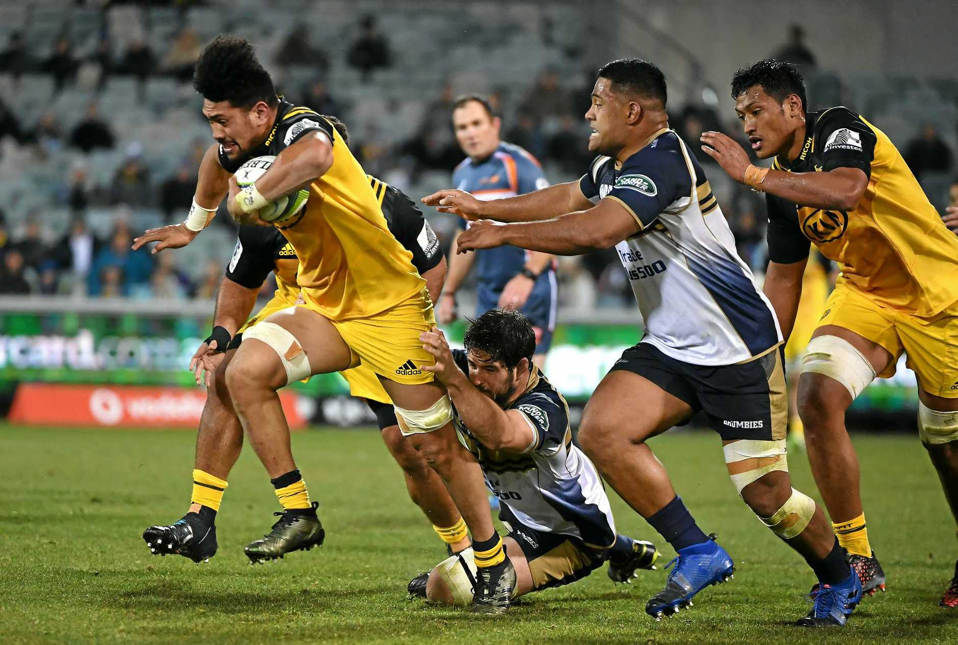 Ardie Savea of the Hurricanes (left) burst through the defensive line in the quarter-final win over the Brumbies.