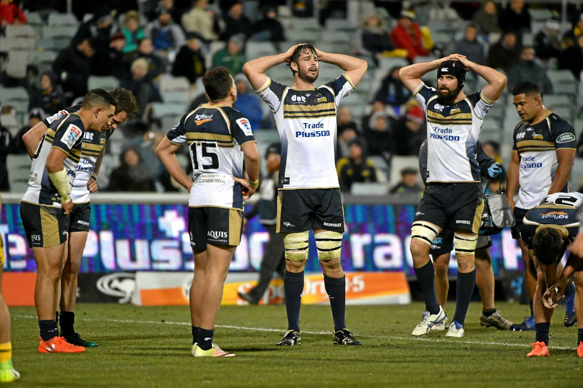 Sam Carter (centre) and Scott Fardy (right) of the Brumbies looks on after the Hurricanes score a try during the quarterfinal Super Rugby match between the Brumbies and the Wellington Hurricanes at GIO Stadium in Canberra, Friday, July 21, 2017. (AAP Image/Mick Tsikas) NO ARCHIVING, EDITORIAL USE ONLY