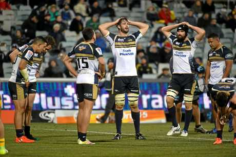 Brumbies players show their disappointment during their quarter-final loss to the Hurricanes.