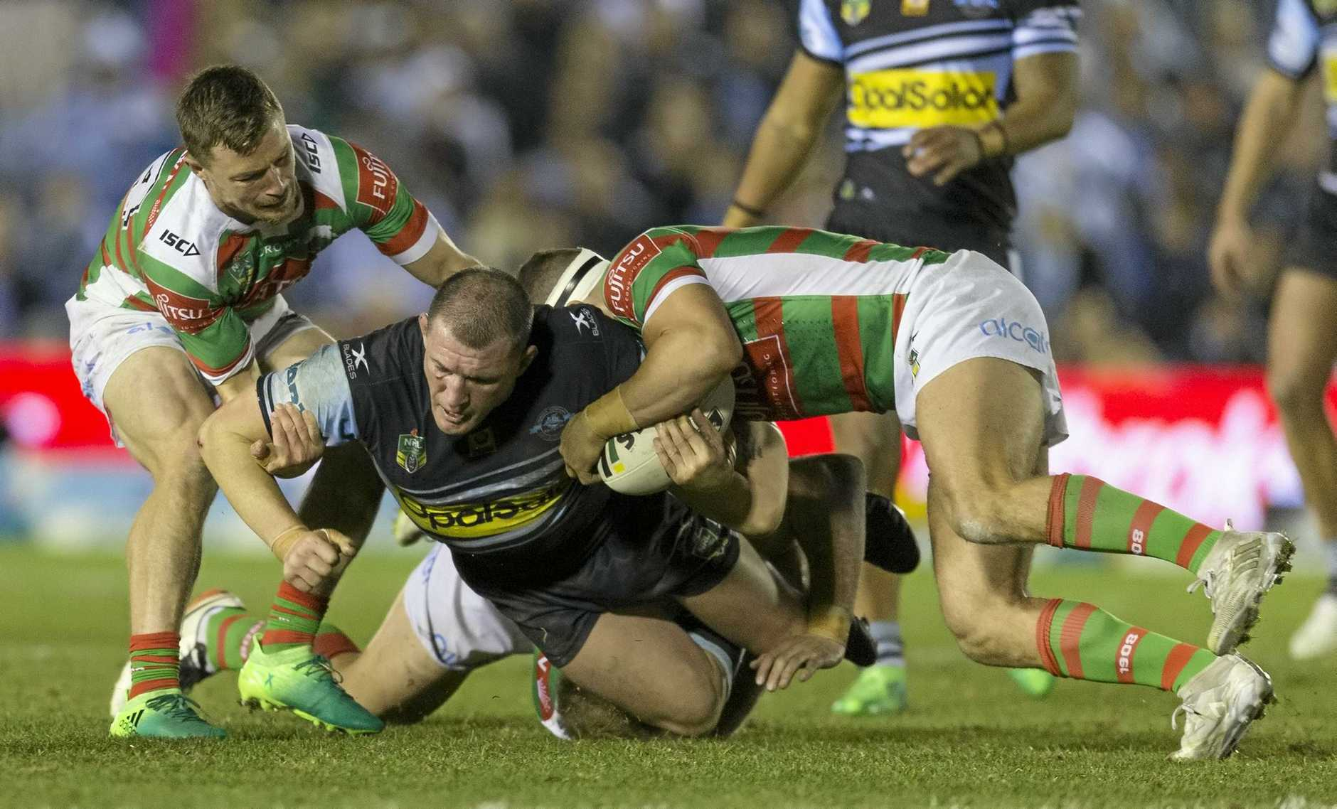 Paul Gallen was is tackled during the Sharks' 26-12 win over South Sydney Rabbitohs on Friday night.