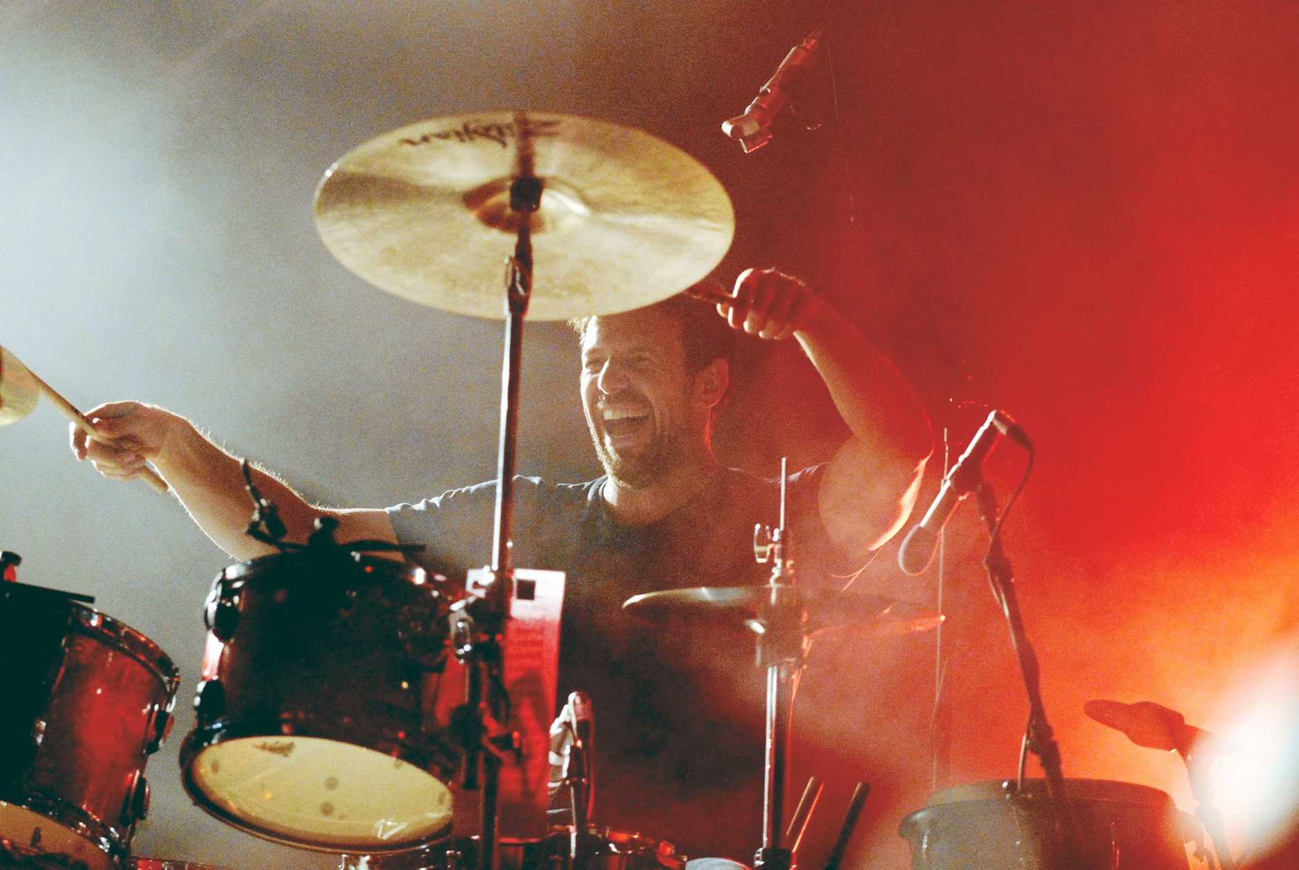 Jon Coghill performs with Powderfinger during the Sunsets farewell tour in Toowoomba in October 2010.