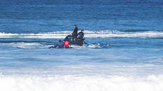 Mick Fanning and Gabriel Medina are plucked from the water after a shark was spotted during their quarter-final clash at the J-Bay Open in South Africa.