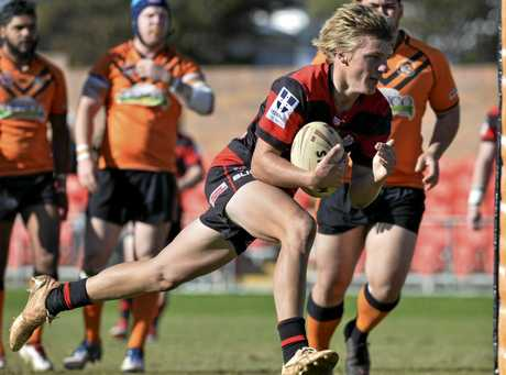 HARD TO HANDLE: Valleys fullback Dylan Chown scores one of his three tries against Souths at Clive Berghofer Stadium.