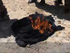Syrians burn burqas and shave beards to spite defeated ISIS
