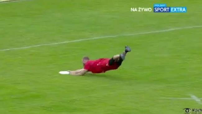 Canada's Geoff Powell completes a full-length dive to catch the frisbee.