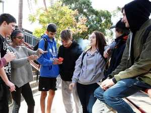"Year 10 students from Warrakirri College enjoy a lunch break and light up some cigarettes in the ""smoking zone"" at the front of the school."