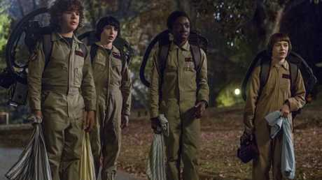 The boys dress up as Ghostbusters.