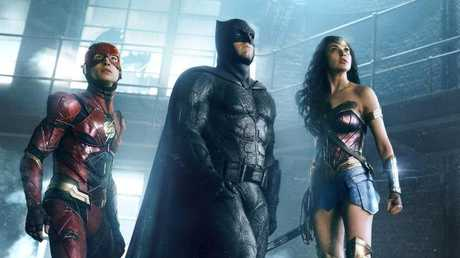 Ezra Miller as The Flash, Ben Affleck as Batman and Gal Gadot as Wonder Woman in a scene from Justice League.