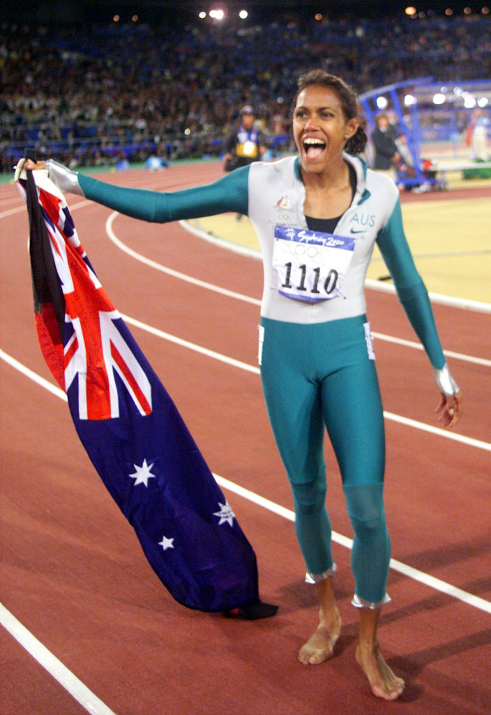 ** ADVANCE FOR WEEKEND EDITIONS, SEPT. 11-12 -FILE - ** This Sept. 25, 2000, file photo shows Australia's Cathy Freeman celebrating after winning the gold medal in the 400-meter race at the Summer Olympics, in Sydney. A decade after winning the race of her life and giving Australia the kind of Olympic memories that can unify a nation, Cathy Freeman is channeling her energy into helping Australia's aborigine population. (AP Photo/Michael Probst, File)