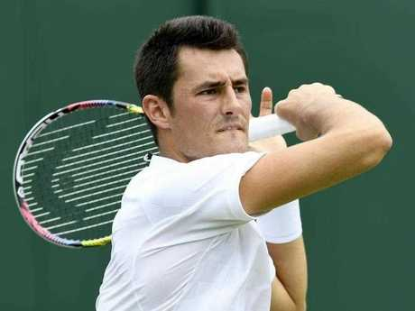 Bernard Tomic of Australia in action against Mischa Zverev of Germany during their first round match for the Wimbledon Championships at the All England Lawn Tennis Club, in London, Britain, 04 July 2017.