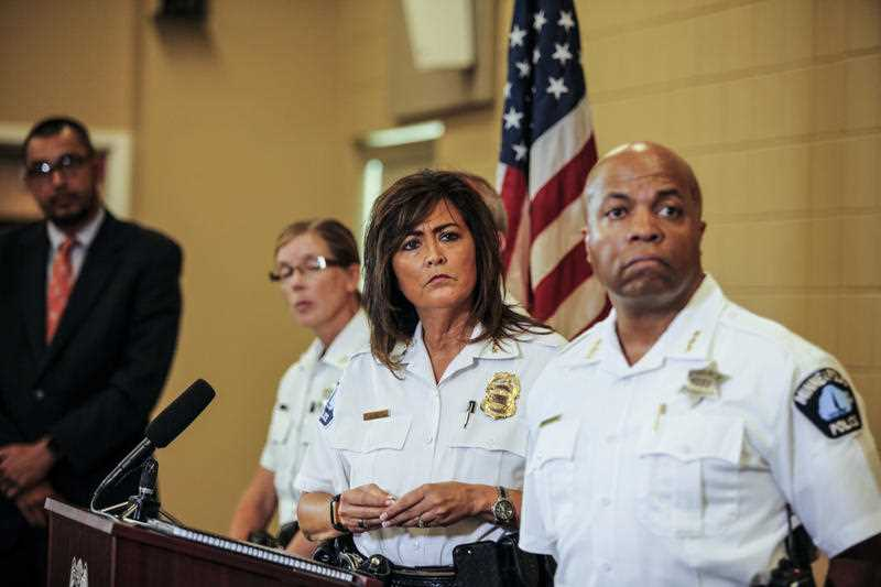 Minneapolis police chief Janee Harteau, center, stands with police inspector Kathy Waite, left, and assistant chief Medaria Arradondo during a news conference in Minneapolis.