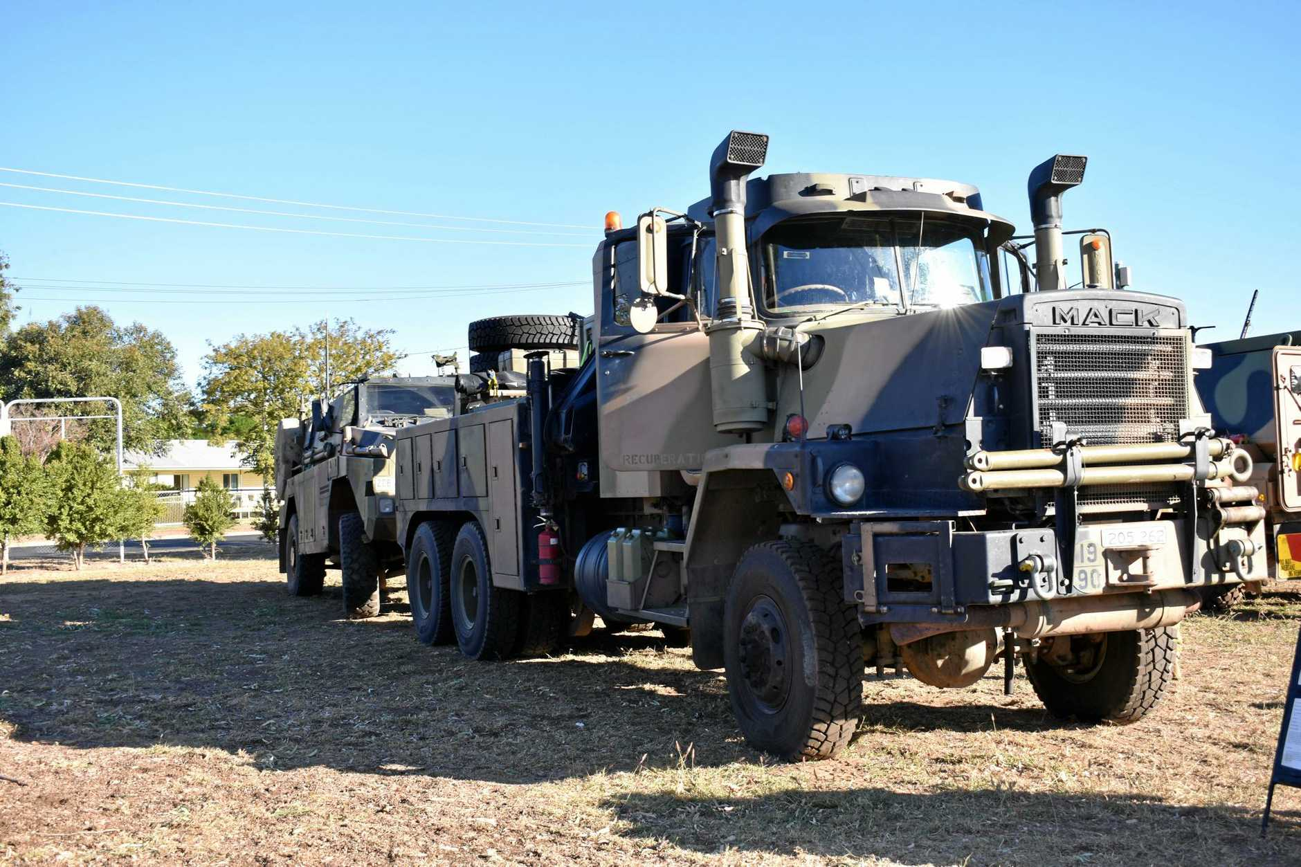Army trucks are still travelling along the highway.