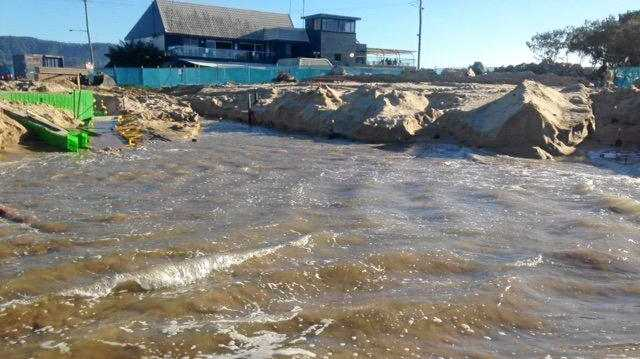 ON HOLD: A medium high tide and waves disrupted the construction of the stepped wall at Jetty Beach.