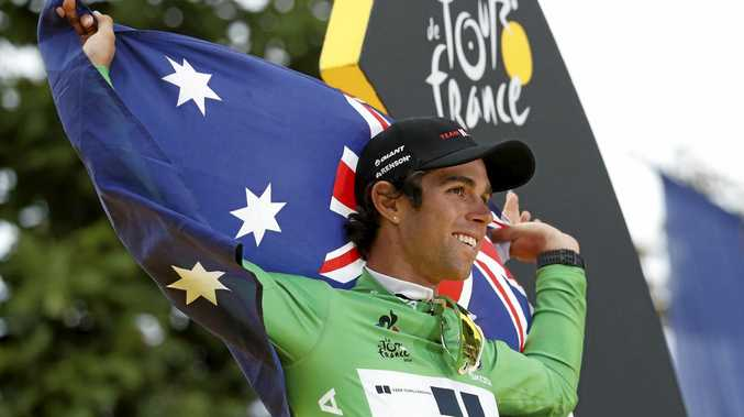 PROUD AUSSIE: Michael Matthews celebrates winning the best sprinter's green jersey after the final stage of the Tour de France in Paris.