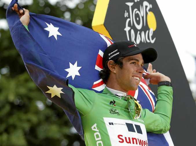 PROUD AUSSIE: Michael Matthews celebrates winning the best sprinter's green jersey after the final stage of the Tour de France in Paris.