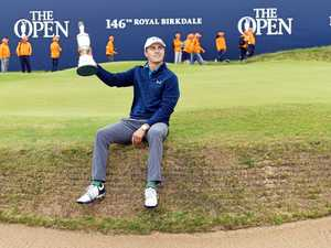AMAZING COMEBACK: Jordan Spieth hoists the Claret Jug trophy after winning the British Open at Royal Birkdale.