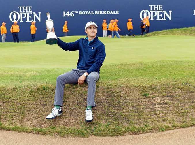 AMAZING COMEBACK: Jordan Spieth hoists the Claret Jug trophy after winning the British Open at Royal Birkdale.