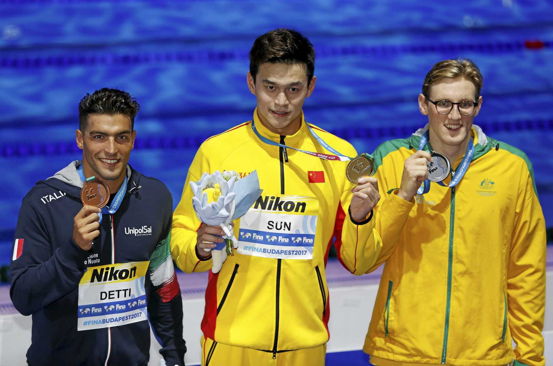 MEDAL WINNERS: China's gold medal winner Sun Yang, flanked by Italy's bronze medal winner Gabriele Detti (left) and Australia's silver medal winner Mack Horton celebrate after the men's 400-meter freestyle final during the world championships in Budapest, Hungary.