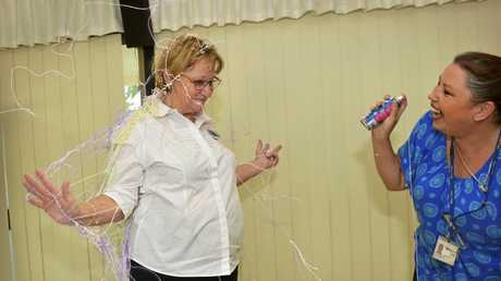 Chris Hartfiel gets covered in silly string.