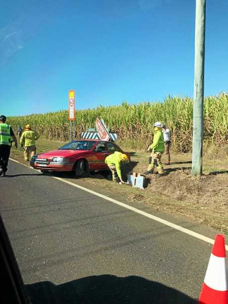 Fire fighters on the scene of the accident at Bargara and Potters Rds.