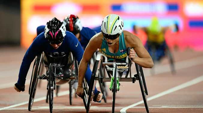 GOLD: Australia's Madison de Rozario celebrates winning gold in the final of the women's 5000m T54 on day nine of the IPC World ParaAthletics Championships.