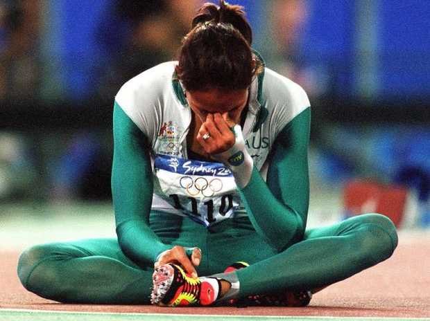 Cathy Freeman reacts after winning gold at the 2000 Olympics.