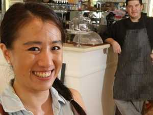 Monica Tjong and husband Gabriele Pirotta at work at their Goji Granola Bar and Cafe at Clear Island Waters. Picture Glenn Hampson
