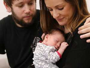 Natalie Forsdike with partner Jonny Spain and their newborn child Finn. Picture: Sam Ruttyn