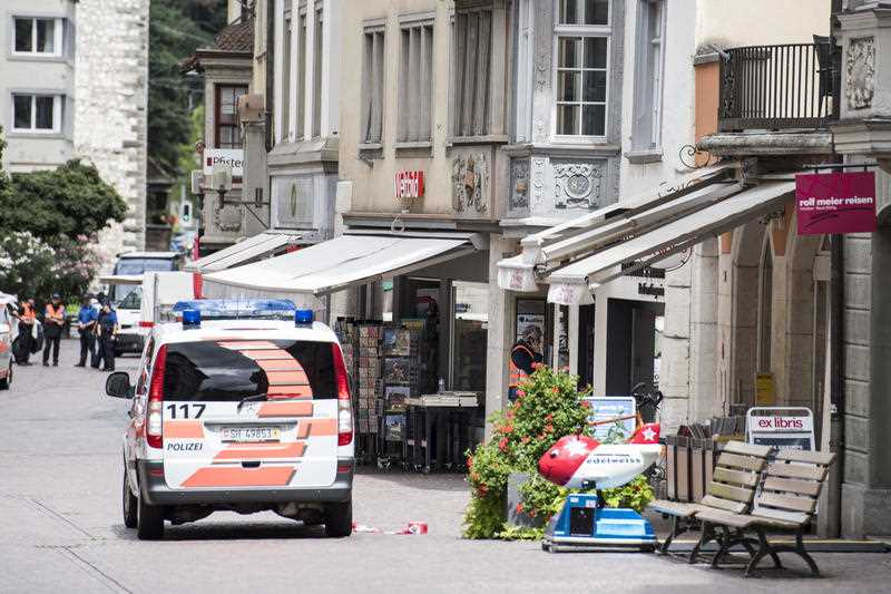 The police investigate in the old town of Schaffhausen in Switzerland, where they search for an unknown man who attacked people, Monday, July 24, 2017. Swiss police say several people have been hospitalised, two of them with serious injuries, following the apparent attack in the northern city of Schaffhausen.