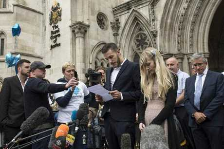 Parents of critically ill baby Charlie Gard, Chris Gard (L) Connie Yates (R) deliver a statement outside the High Court in central London, Britain, 24 July 2017.