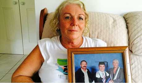 STANDING FIRM: Yvonne, pictured holding a treasured photograph at her son's graduation, .