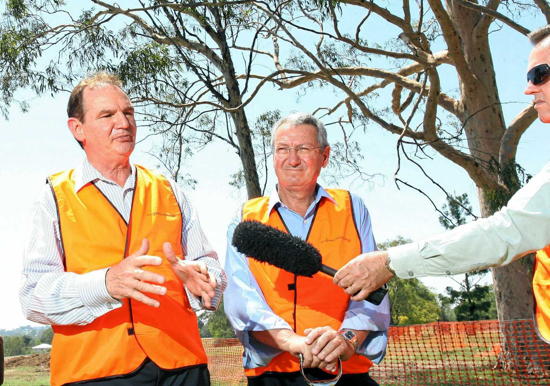 BROTHERLY LOVE: Former Ipswich Mayor Paul Pisasale with his brother Cr Charlie Pisasale announcing an $80 million residential development at Leichhardt in 2009.