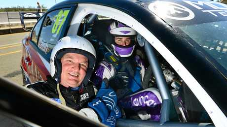 REVVED UP: Paul Pisasale prepares for a hot lap in a V8 Supercar with Ipswich driver Ash Walsh in 2013. Mr Pisasale was heartened to learn this week that a 10-year sponsorship deal with Supercars had been struck by Ipswich City Council.