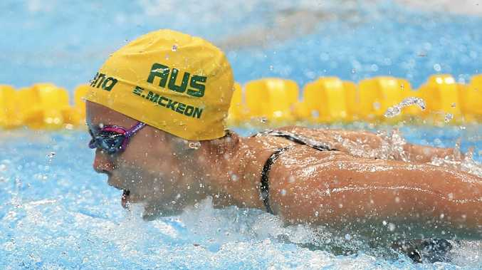 Australia's Emma McKeon competes in a women's 100m butterfly.