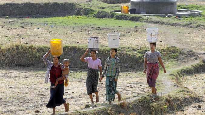 Myanmar women collect drinking water from the outskirts of the capital, Naypyitaw, Myanmar, in the El Nino-affected summer of 2016.