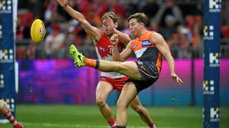 GWS Giants star Toby Greene attempts a shot at goal during his side's AFL Round 17 match with the Sydney Swans.