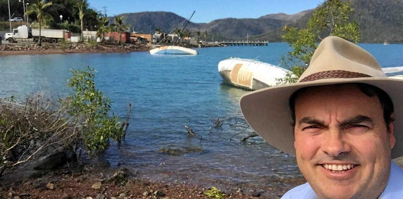 CALING IT: Whitsunday MP Jason Costigan at cyclone damaged Shute Harbour.