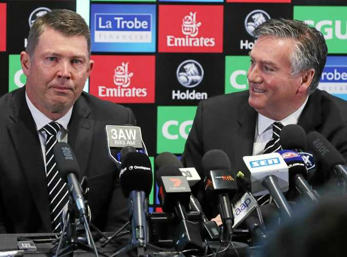 Collingwood CEO Gary Pert (left) announces his resignation at a press conference beside club president Eddie McGuire.