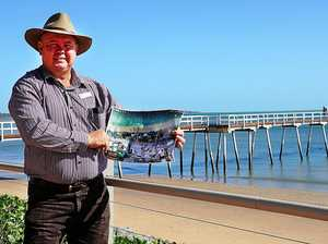 LIGHT IT UP: Cr Denis Chapman displays the proposed area for the Scarness beach lights, which would cover an area of 300m of the foreshore.
