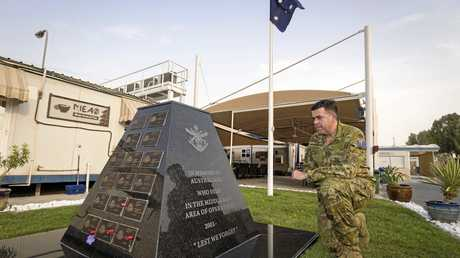 Milton Dick next to the memorial to fallen soldiers at Australia's main operating base in the Middle East region.