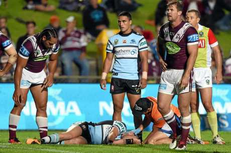 Jack Bird of the Sharks receives medical attention after being taken out by Martin Taupau (left) of the Sea Eagles last year.