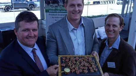 AgForce general president Grant Maudsley with Alisterand Lachlan Hughes and some Rangeland beef.