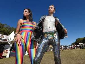 Courtney Smoulden and Dylan Barker sporting some of the extensive glitter available at Splendour in the Grass 2017 near Byron Bay.