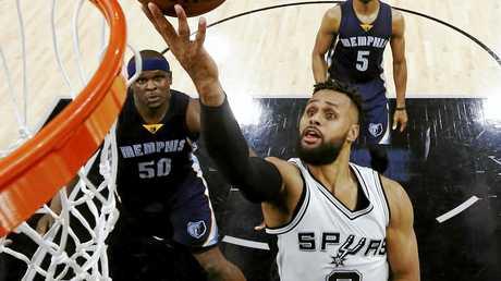 San Antonio Spurs guard Patty Mills goes to the basket.